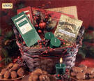 4563Q HOLLY BASKET - Quick Ship - This holiday basket is full of treats including chocolates, cocoa, toffee, and candles with a glass holder.